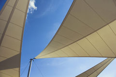 Bottom view of triangle shaped big sun shades stock photo