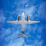 Bottom view - twin prop airplane on sky background. Bottom view - twin prop cargo plane on sky background stock images