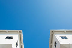 Bottom view of two small houses. Royalty Free Stock Images