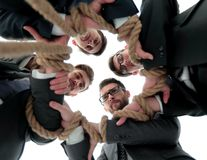 Bottom view.unified business team. Holding strong rope.closeup Royalty Free Stock Image