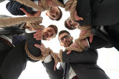 Bottom view.unified business team. Holding strong rope.closeup Stock Photography