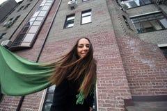 beautiful woman black coat green scarf royalty free stock images