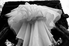 Bottom view of wedding dress hanging on the arbor. Abstract overhang wedding dress royalty free stock photos