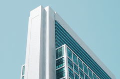Bottom View of White and Blue Curtain Wall Building during Daytime Royalty Free Stock Image
