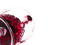 Bottom view of wine being poured into a glass. Isolated on white Stock Image