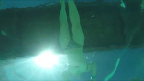 Bottom view of a woman floating under a bridge. Bottom view of a young woman floating under a bridge stock footage