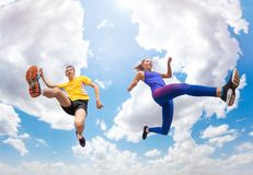 Athletes remains in air while jumping against sky royalty free stock photography