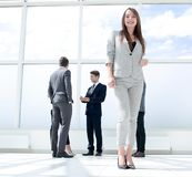Bottom view.young businesswoman standing in a spacious lobby stock photography