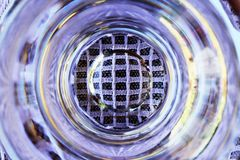 Bottom of water filled glass Stock Photo