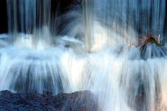 Bottom of waterfall. Water hitting rocks at bottom of waterfall Stock Images