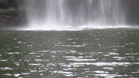 The bottom of a waterfall. This region of Australia, sustains an indigenous ecology named `dry rainforest`, that is World Heritage listed as the only example of stock video footage
