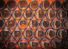 Bottoms of brown color bottles. Closeup bottoms of brown color bottles background Stock Photo