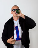 Bottoms Up. A man ready to party drinks some beer Royalty Free Stock Photography