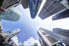 Tall Skyscrapers in Downtown Business Financial District. Bottoms-up view of business office skyscrapers and highrise buildings in Singapore`s business and Royalty Free Stock Photos
