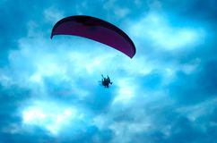 Botton up view of a paraglider flying. On the sky Stock Photography