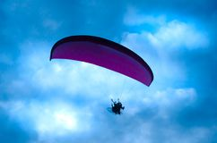 Botton up view of a paraglider flying. On the sky Stock Image