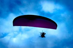 Botton up view of a paraglider flying. On the sky Royalty Free Stock Images