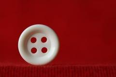 Bottone bianco dell'abbigliamento Fotografie Stock Libere da Diritti