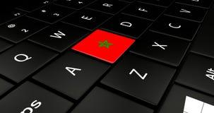 Bottone della bandiera del Marocco sulla tastiera del computer portatile Fotografia Stock