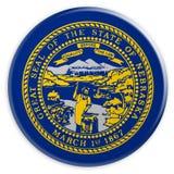 Bottone dello stato USA: Illustrazione del distintivo 3d della bandiera del Nebraska su fondo bianco royalty illustrazione gratis