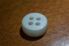 Bottone di camicia Fotografia Stock