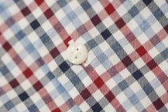 Bottone di camicia del plaid del cotone dell'uomo fotografia stock