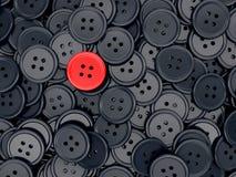 Bottone di cucito rosso unico Fotografie Stock