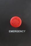 Bottone di plastica rosso dell'arresto di emergenza Immagine Stock