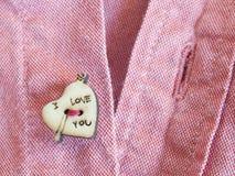 Bottone a forma di del cuore Immagini Stock