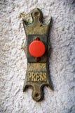 Bottone rosso bronzeo Fotografia Stock Libera da Diritti