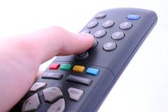 Bottone telecomandato di stampaggio a mano isolato su bianco Fotografia Stock