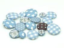 Bottoni blu e marroni del tessuto isolati illustrazione vettoriale