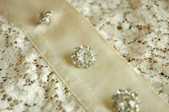 Bottoni del cristallo di rocca su un vestito d'annata Immagini Stock