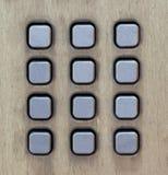 Bottoni del metallo di un contenitore di telefono della via Fotografie Stock
