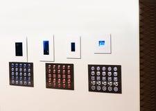 Bottoni dell'elevatore 3 pannelli su fondo bianco Fotografia Stock