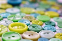 Bottoni di cucito blu-verde luminosi Immagini Stock