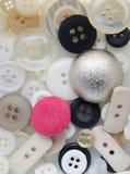 Bottoni di cucito, bottoni fondo, fine su Fotografia Stock