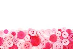 Bottoni di cucito rosa fotografia stock