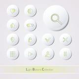 Bottoni lucidi leggeri su fondo bianco Fotografia Stock Libera da Diritti