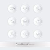 Bottoni lucidi leggeri su fondo bianco Immagini Stock Libere da Diritti