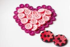 Bottoni nella forma di cuore Immagine Stock