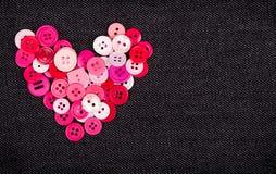 Bottoni rosa nella forma di cuore Fotografia Stock