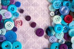 Bottoni su struttura grungy del fondo fotografia stock
