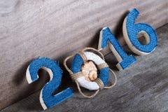 Bouée de sauvetage au lieu du chiffre 0 dans le numéro 2016 et le coquillage Image stock