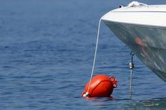 Bouée en mer bleue Photos libres de droits
