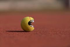 Bouche de balle de tennis Image libre de droits