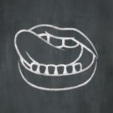 Bouche de craie léchant des lèvres Images libres de droits