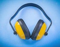Bouche-oreilles sur le concept bleu de construction de fond Photos libres de droits