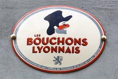 Bouchons Lyonnais logo på en vägg Royaltyfri Foto