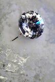 Boucle d'oreille de costume sur la glace Images libres de droits